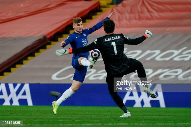 Chelsea's German striker Timo Werner beats Liverpool's Brazilian goalkeeper Alisson Becker to the ball and puts the ball in the net but the goal is...