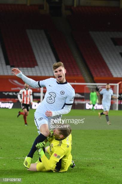 Chelsea's German striker Timo Werner collides with Sheffield United's English goalkeeper Aaron Ramsdale resulting in a penalty during the English...