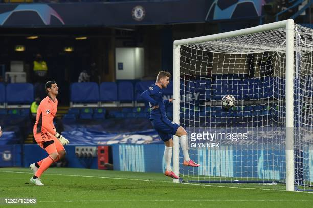 Chelsea's German striker Timo Werner headers a rebounding ball to scores the opening goal during the UEFA Champions League second leg semi-final...