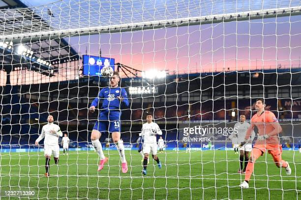 Chelsea's German striker Timo Werner headers a rebounding ball to score the opening goal during the UEFA Champions League second leg semi-final...