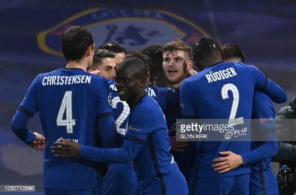 Chelsea's German striker Timo Werner is mobbed by teammates after scoring the opening goal during the UEFA Champions League second leg semi-final...