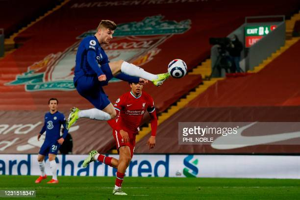Chelsea's German striker Timo Werner leaps to meet the ball during the English Premier League football match between Liverpool and Chelsea at Anfield...