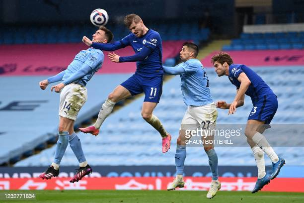 Chelsea's German striker Timo Werner vies with Manchester City's French defender Aymeric Laporte and Manchester City's Portuguese defender Joao...