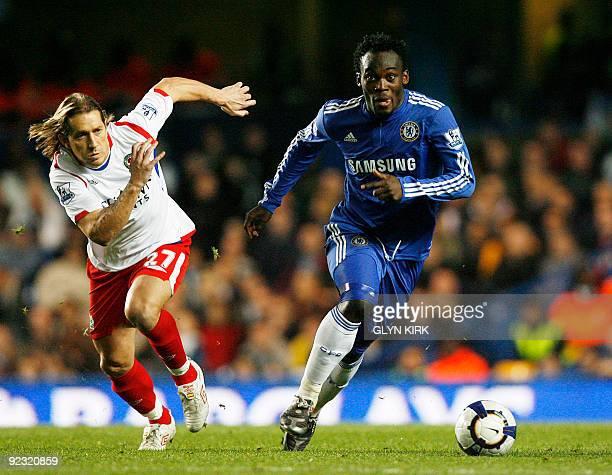 Chelsea's Ghanaian midfielder Michael Essien vies with Blackburn's Spanish defender Michel Salgado during their English Premier League football match...