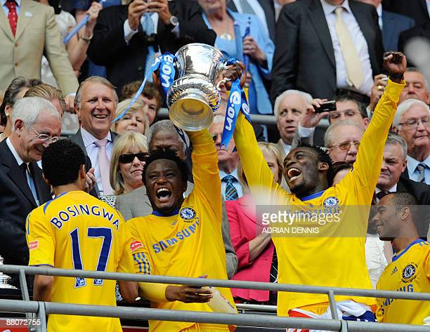 Chelsea's Ghanian footballer Michael Essien and Nigerian footballer John Obi Mikel lift the FA Cup as they celebrate beating Everton 21 in the FA Cup...