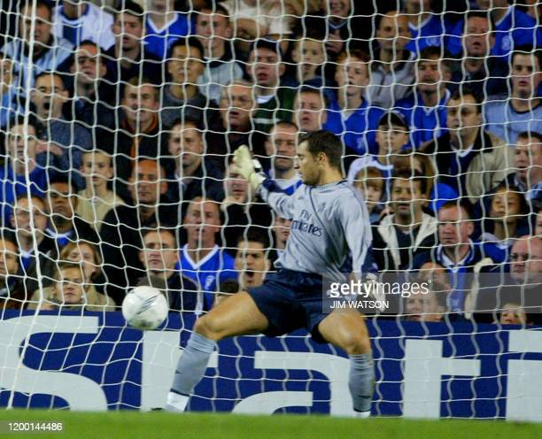 Chelsea's goal keeper Carlo Cudicini watches the ball go into the goal on a kick from Besiktas' Sergen Yalcin during their Champions League match at...