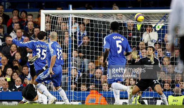 Chelsea's goalkeeper Carlo Cudicini watches as the ball goes over his head after Everton's Tim Cahill scored with a late equaliser with an overhead...