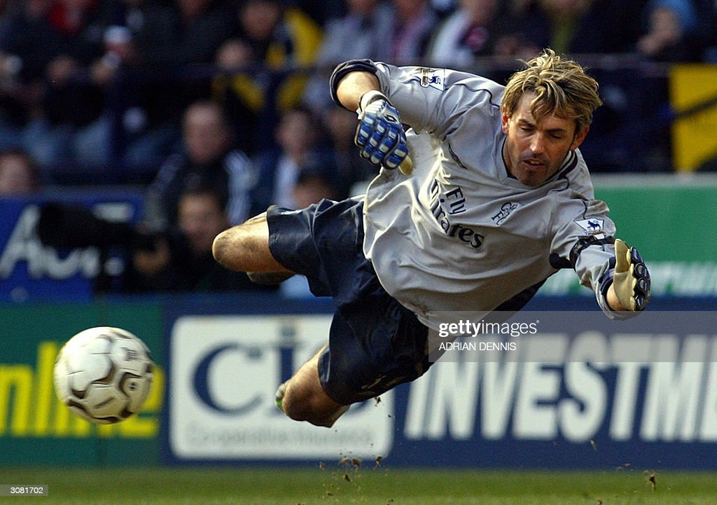 Chelsea's goalkeeper Marco Ambrosio dives to make a save during the Premiership football match against Bolton Wanderers at The Reebok Stadium in Bolton, 13 March 2004. Ambrosio, Chelsea's third string keeper, made crucial first half saves to keep Chelsea in the match. Chelsea won the game 2-0. AFP PHOTO Adrian DENNIS