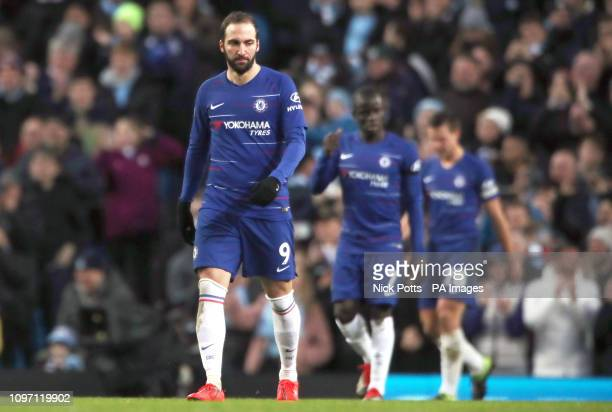 Chelsea's Gonzalo Higuain appears dejected after Manchester City's Sergio Aguero scores his side's fifth goal of the game from the penalty spot...