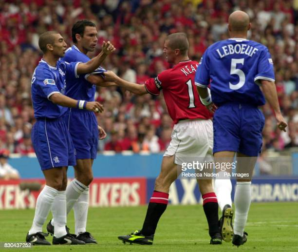 Chelsea's Gustavo Poyet has his shirt pulled by Manchester United captain Roy Keane during the FA Charity Shield at Wembley Stadium
