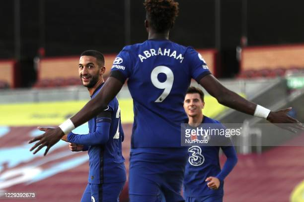 Chelseas Hakim Ziyech celebrates with Chelsea's Tammy Abraham scoring his side's first goal of the game during the Premier League match between...
