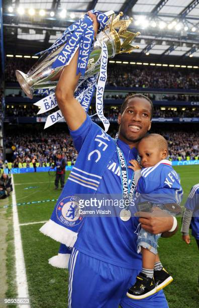 Chelsea's hat trick hero Didier Drogba celebrates with the trophy after winning the league with an 80 victory during the Barclays Premier League...