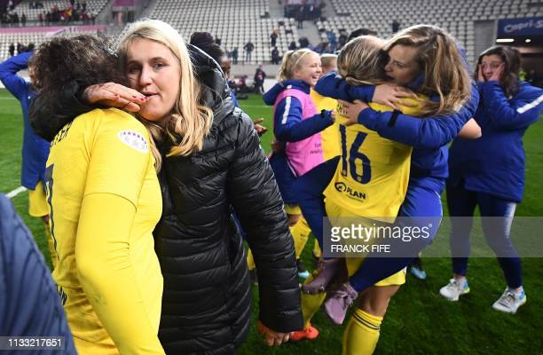 Chelsea's head coach Emma Hayes and her players celebrate their qualification for the next round after the UEFA Women's Champions League quarter...