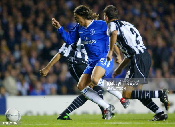 Chelsea's Hernan Crespo slips past Besiktas' Asik Emre before attempting a shot on the goal during their Champions League match at Stamford Bridge...