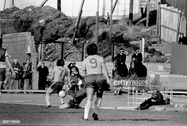 Chelsea's Ian Britton and Alan Mayes attack the goal in front of an unusual Football League backdrop during the Football League Division Two match...