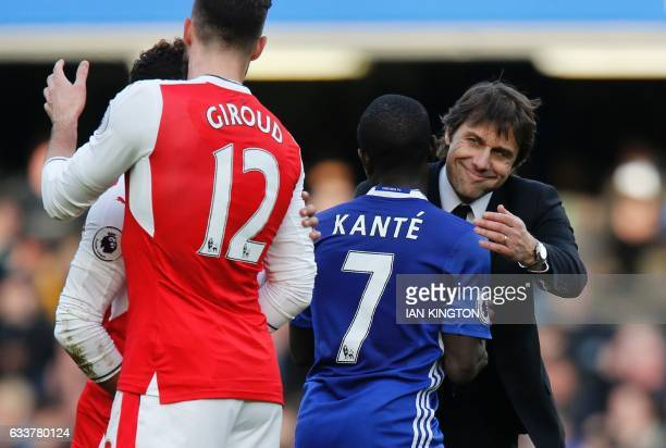 Chelsea's Italian assistant coach Gianluca Conte embraces Chelsea's French midfielder N'Golo Kante during the English Premier League football match...