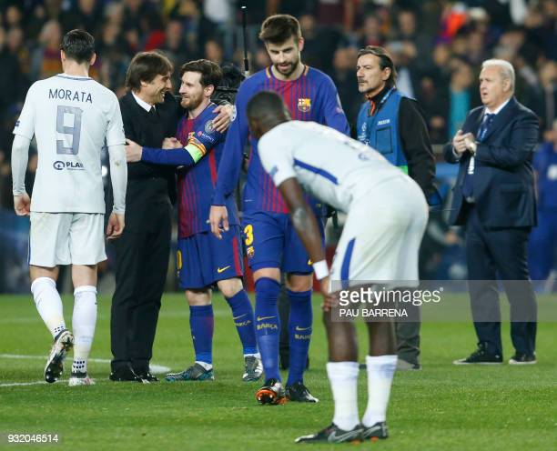Chelsea's Italian coach Antonio Conte talks with Barcelona's Argentinian forward Lionel Messi after the UEFA Champions League round of sixteen second...