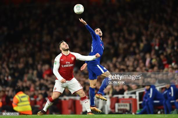 Chelsea's Italian defender Davide Zappacosta vies with Arsenal's German midfielder Mesut Ozil during the League Cup semifinal football match between...