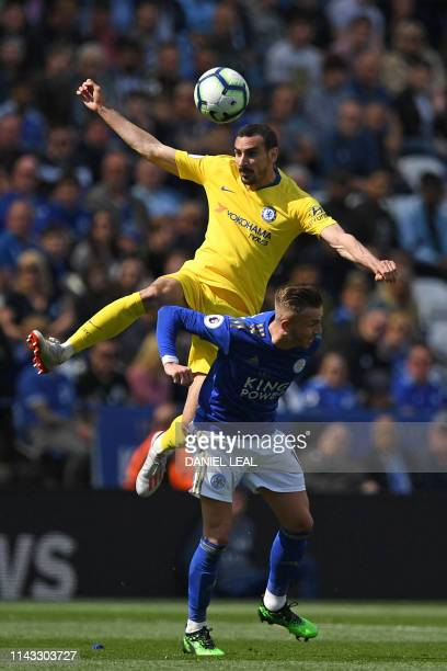 Chelsea's Italian defender Davide Zappacosta wins a header from Leicester City's English midfielder James Maddison during the English Premier League...