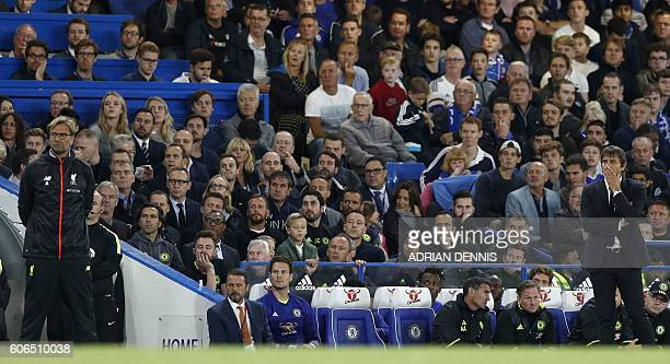 Chelsea's Italian head coach Antonio Conte and Liverpool's German manager Jurgen Klopp watch they play during the English Premier League football...