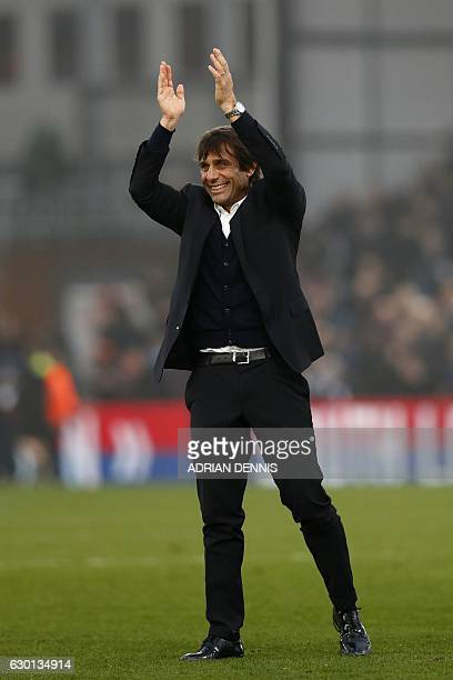Chelsea's Italian head coach Antonio Conte applauds the fans following the English Premier League football match between Crystal Palace and Chelsea...