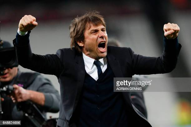 TOPSHOT Chelsea's Italian head coach Antonio Conte applauds the fans following the English Premier League football match between West Ham United and...