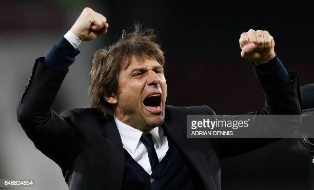 Chelsea's Italian head coach Antonio Conte applauds the fans following the English Premier League football match between West Ham United and Cheslsea...