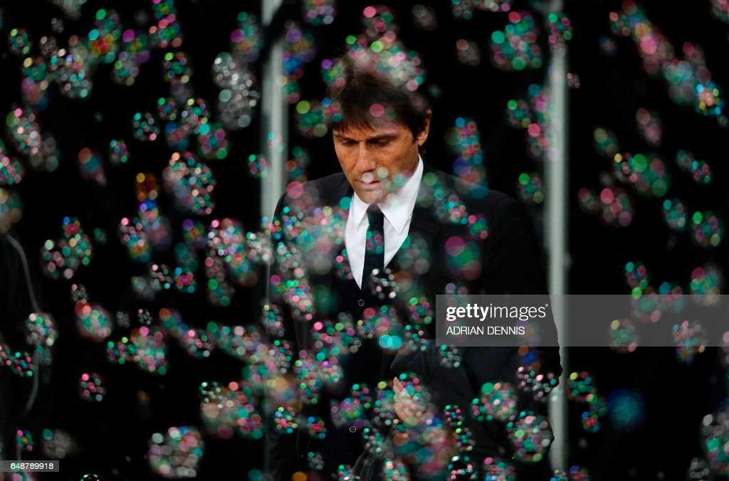TOPSHOT - Chelsea's Italian head coach Antonio Conte arrives ahead of the English Premier League football match between West Ham United and Cheslsea at The London Stadium in east London on March 6, 2017. / AFP PHOTO / Adrian DENNIS / RESTRICTED TO EDITORIAL USE. No use with unauthorized audio, video, data, fixture lists, club/league logos or 'live' services. Online in-match use limited to 75 images, no video emulation. No use in betting, games or single club/league/player publications. /