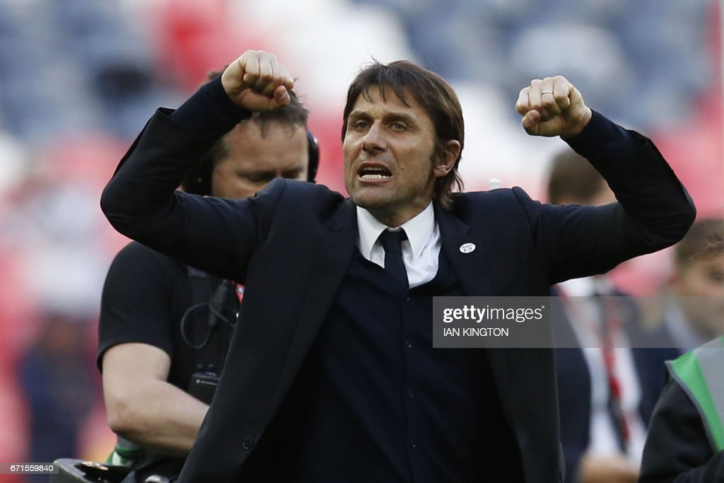 Chelsea's Italian head coach Antonio Conte celebrates after winning the FA Cup semi-final football match between Tottenham Hotspur and Chelsea at Wembley stadium in London on April 22, 2017. / AFP PHOTO / Ian KINGTON / NOT