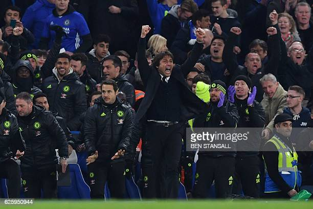 Chelsea's Italian head coach Antonio Conte celebrates at the final whistle during the English Premier League football match between Chelsea and...