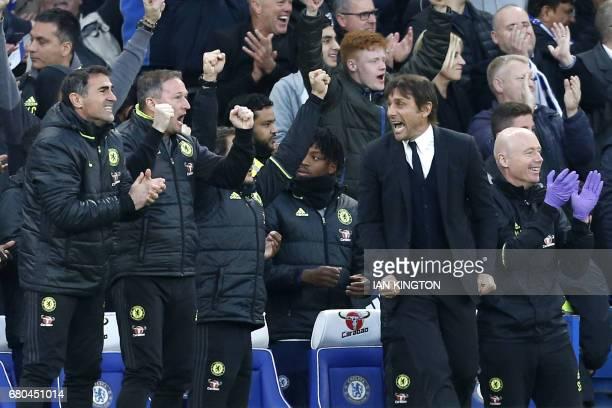 Chelsea's Italian head coach Antonio Conte celebrates Chelsea's Brazilianborn Spanish striker Diego Costa's goal during the English Premier League...