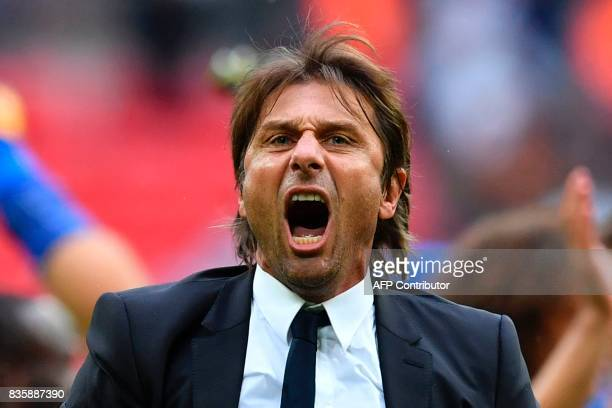 Chelsea's Italian head coach Antonio Conte celebrates on the pitch at the end of the English Premier League football match between Tottenham Hotspur...