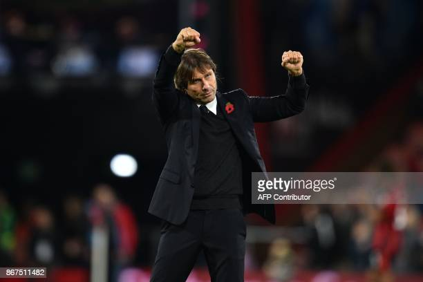 Chelsea's Italian head coach Antonio Conte celebrates on the pitch after the English Premier League football match between Bournemouth and Chelsea at...