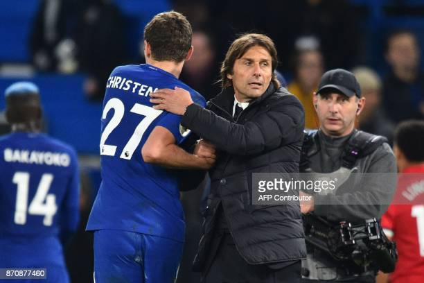 Chelsea's Italian head coach Antonio Conte celebrates on the pitch with Chelsea's Danish defender Andreas Christensen after the English Premier...