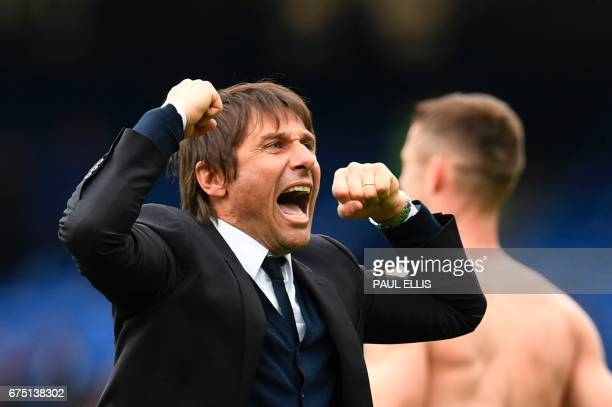 Chelsea's Italian head coach Antonio Conte celebrates victory at the end of the English Premier League football match between Everton and Chelsea at...