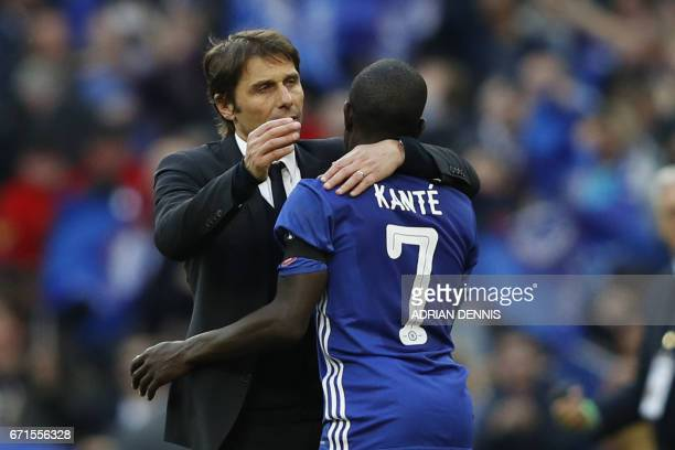 Chelsea's Italian head coach Antonio Conte celebrates victory with Chelsea's French midfielder N'Golo Kante after the FA Cup semifinal football match...