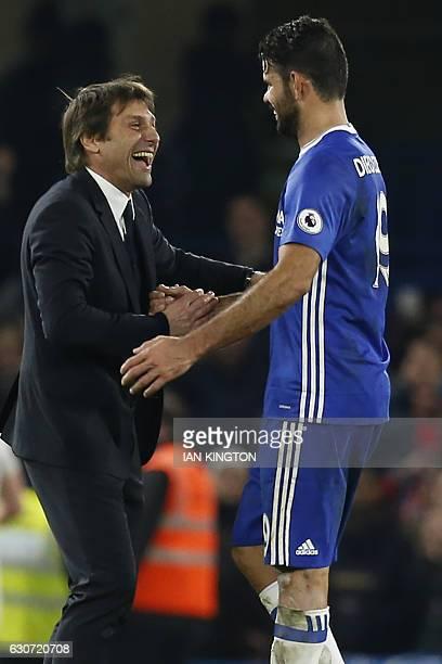 Chelsea's Italian head coach Antonio Conte celebrates with Chelsea's Brazilianborn Spanish striker Diego Costa on the pitch after the English Premier...