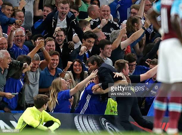 Chelsea's Italian head coach Antonio Conte celebrates with supporters after Chelsea's Brazilianborn Spanish striker Diego Costa scores their late...