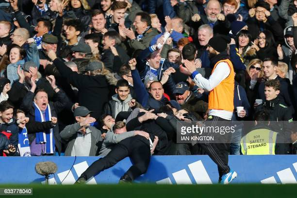 Chelsea's Italian head coach Antonio Conte celebrates with the crowd after Chelsea's Belgian midfielder Eden Hazard scored their second goal during...