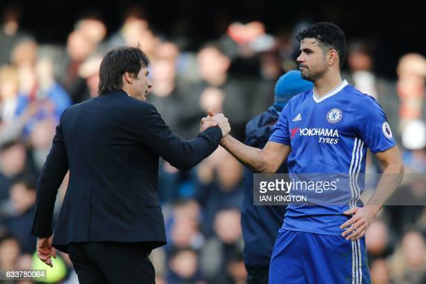 Chelsea's Italian head coach Antonio Conte embraces Chelsea's Brazilianborn Spanish striker Diego Costa during the English Premier League football...