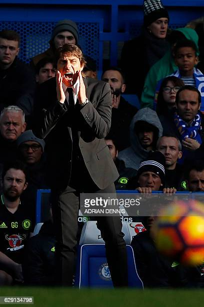 Chelsea's Italian head coach Antonio Conte gestures from the touchline in the sunshine during the English Premier League football match between...