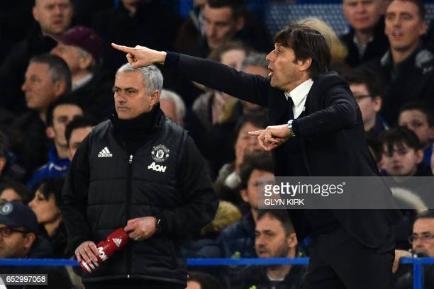 Chelsea's Italian head coach Antonio Conte gestures on the touchline as Manchester United's Portuguese manager Jose Mourinho looks on during the...