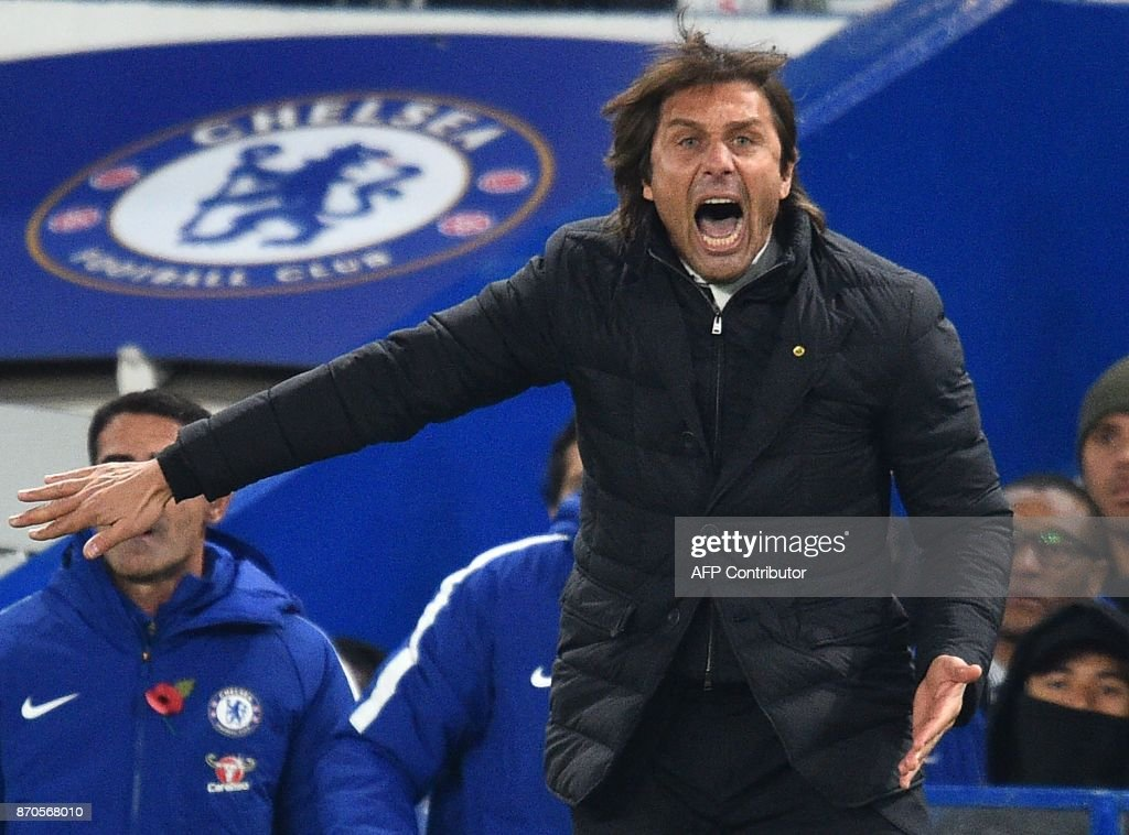 Chelsea's Italian head coach Antonio Conte gestures on the touchline during the English Premier League football match between Chelsea and Manchester United at Stamford Bridge in London on November 5, 2017. / AFP PHOTO / Glyn KIRK / RESTRICTED TO EDITORIAL USE. No use with unauthorized audio, video, data, fixture lists, club/league logos or 'live' services. Online in-match use limited to 75 images, no video emulation. No use in betting, games or single club/league/player publications. /