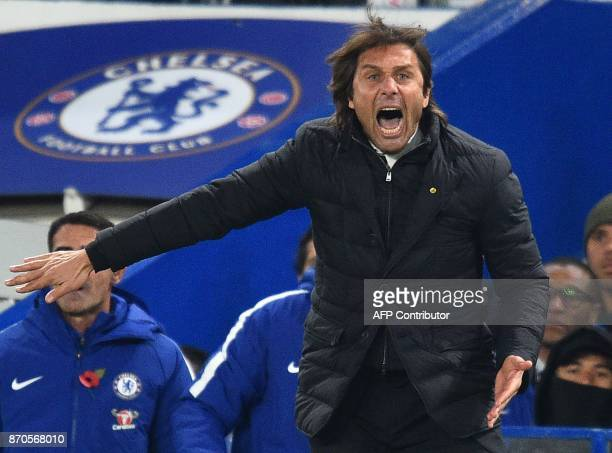 Chelsea's Italian head coach Antonio Conte gestures on the touchline during the English Premier League football match between Chelsea and Manchester...