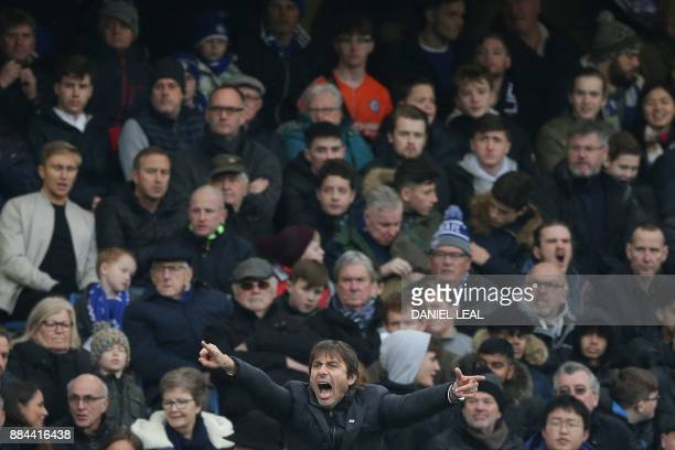 Chelsea's Italian head coach Antonio Conte gestures on the touchline during the English Premier League football match between Chelsea and Newcastle...