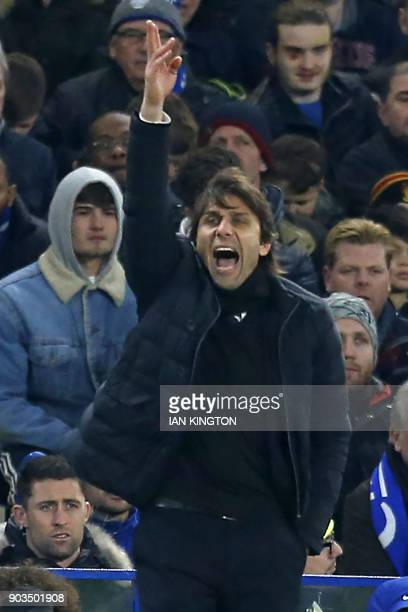 Chelsea's Italian head coach Antonio Conte gestures on the touchline during the English League Cup semifinal first leg football match between Chelsea...