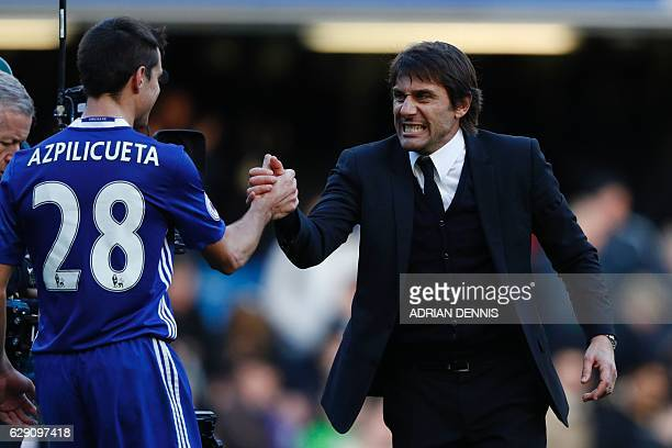 Chelsea's Italian head coach Antonio Conte gestures to Chelsea's Spanish defender Cesar Azpilicueta after the English Premier League football match...