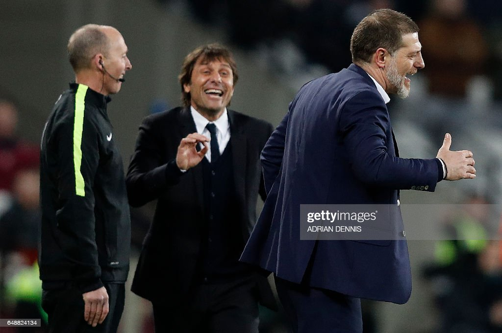 TOPSHOT - Chelsea's Italian head coach Antonio Conte (L) gestures towards West Ham United's Croatian manager Slaven Bilic during the English Premier League football match between West Ham United and Cheslsea at The London Stadium in east London on March 6, 2017. Chelsea won the match 2-1. / AFP PHOTO / Adrian DENNIS / RESTRICTED TO EDITORIAL USE. No use with unauthorized audio, video, data, fixture lists, club/league logos or 'live' services. Online in-match use limited to 75 images, no video emulation. No use in betting, games or single club/league/player publications. /