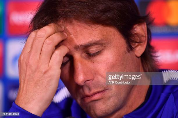 Chelsea's Italian head coach Antonio Conte give a press conference at Chelsea's Cobham training facility in Stoke D'Abernon southwest of London on...