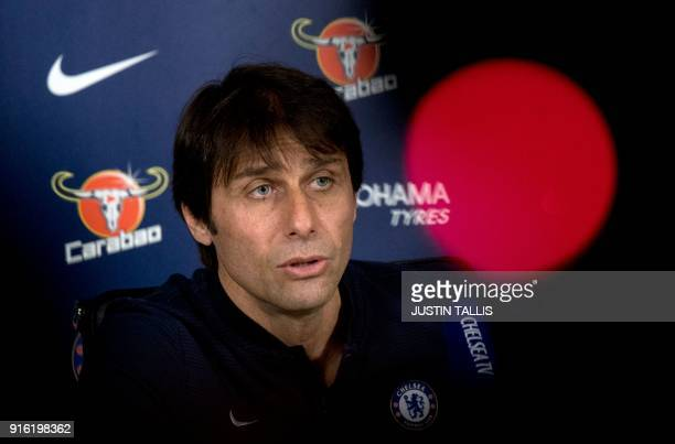 Chelsea's Italian head coach Antonio Conte gives a press conference at Chelsea's Cobham training facility in Stoke D'Abernon southwest of London on...